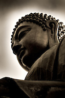 A close-up of Tian Tan Buddha on Lantau Island, Hong Kong. This is one of the world's tallest outdoor bronze buddhas and is reached after climbing 268 steps.