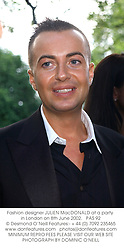 Fashion designer JULIEN MacDONALD at a party in London on 8th June 2002.<br />PAS 92