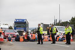 Enfield, UK. 15th September, 2021. Insulate Britain climate activists block for a second time a slip road from the M25 at Junction 25 as part of a campaign intended to push the UK government to make significant legislative change to start lowering emissions. The activists, who wrote to Prime Minister Boris Johnson on 13th August, are demanding that the government immediately promises both to fully fund and ensure the insulation of all social housing in Britain by 2025 and to produce within four months a legally binding national plan to fully fund and ensure the full low-energy and low-carbon whole-house retrofit, with no externalised costs, of all homes in Britain by 2030 as part of a just transition to full decarbonisation of all parts of society and the economy.