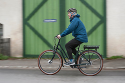 Mature man with cycling helmet on his bicycle, Bavaria, Germany