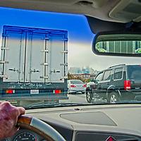 A driver navigates traffic merging towards the Bay Bridge in San Francisco, California.