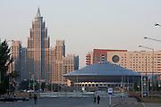 "Triumf Astana (Triumph of Astana) appartment building (l.), the Circus (""UFO"") at dawn."