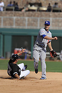 GLENDALE, AZ - MARCH 5:  Jason Repko #17 of the Los Angeles Dodgers throws over a sliding Paul Konerko #14 of the Chicago White Sox on March 5, 2010 at The Ballpark at Camelback Ranch in Glendale, Arizona. (Photo by Ron Vesely)