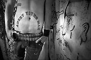 """Guadalajara, Jalisco, México 2009. Alvaro, canta en una banda de música punk llamada DIAS DE RADIO, otro de sus tatuajes """"ANGRY YOUNG  MAN"""" enfatiza su actitud hacia las normas establecidas o las formas de poder instituídas. <br /> foto giorgio viera."""