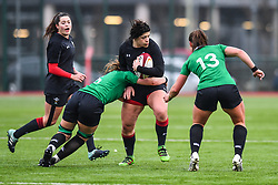 Wales women's Rebecca De Filippo is tackled by Ireland women's Anna Caplice<br /> <br /> Photographer Craig Thomas/Replay Images<br /> <br /> International Friendly - Wales women v Ireland women - Sunday 21th January 2018 - CCB Centre for Sporting Excellence - Ystrad Mynach<br /> <br /> World Copyright © Replay Images . All rights reserved. info@replayimages.co.uk - http://replayimages.co.uk