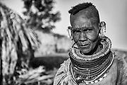 A black and white portrait of a Rendille tribe women wearing beaded necklaces,black and white, Lake Turkana, Loiyangalani,Kenya, Africa