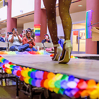 A crowd of students and faculty cheers and photographs performers during the UNM-Gallup LGTBQ Welcome Back Days celebration Wednesday at UNM-G.