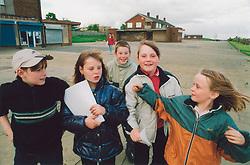 Children playing near shops; Bradford Yorkshire UK