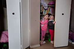 Four-year-old craniopagus twins Tatiana and Krista Hogan play in their home in Vernon, British Columbia, Canada, Feb. 28, 2011. The twins, born Oct. 25, 2006 to parents Felicia Simms and Brendan Hogan, are connected at the head and share a brain. Neurologists say the twins are the only such set that have a common neurological connection.