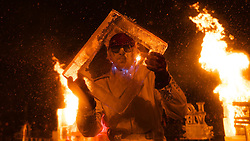 The Fear No Ice team turns up the heat in the Carson St. parking lot. (Bas Slabbers/for NewsWorks)<br /> <br /> http://www.newsworks.org/index.php/component/flexicontent/items/item/50760-manayunk-on-ice-