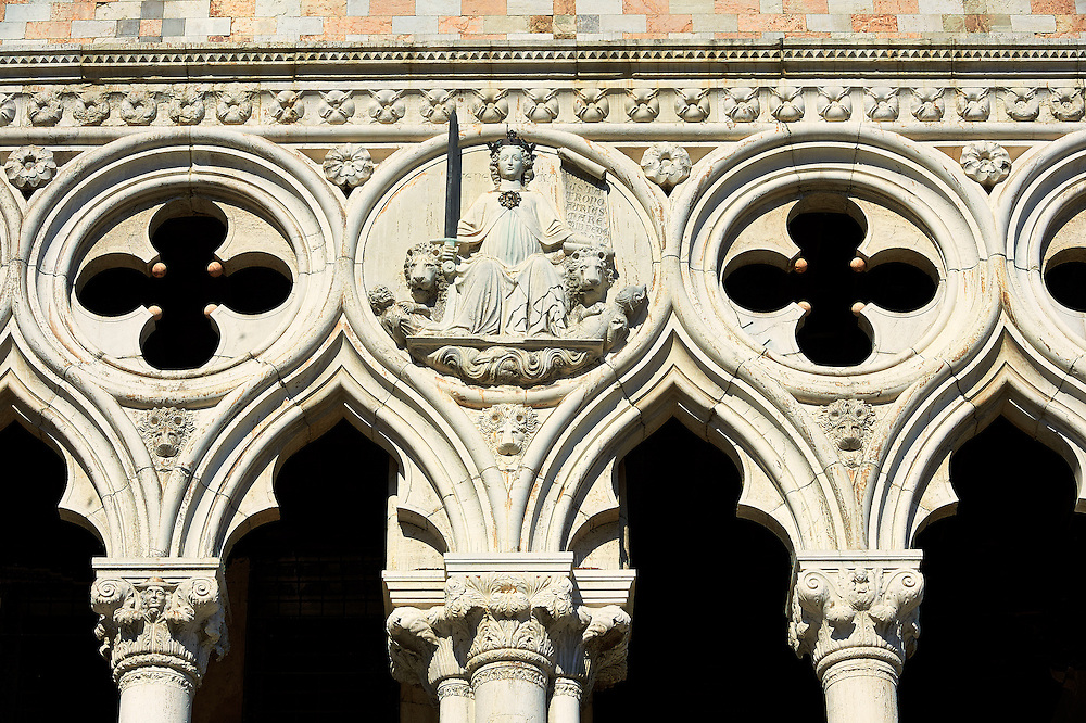 The 14th Century Gothic style architectural details of The Doge's Palace on St Marks Square, Palazzo Ducale, Venice Italy .<br /> <br /> Visit our ITALY HISTORIC PLACES PHOTO COLLECTION for more   photos of Italy to download or buy as prints https://funkystock.photoshelter.com/gallery-collection/2b-Pictures-Images-of-Italy-Photos-of-Italian-Historic-Landmark-Sites/C0000qxA2zGFjd_k<br /> <br /> <br /> Visit our MEDIEVAL PHOTO COLLECTIONS for more   photos  to download or buy as prints https://funkystock.photoshelter.com/gallery-collection/Medieval-Middle-Ages-Historic-Places-Arcaeological-Sites-Pictures-Images-of/C0000B5ZA54_WD0s