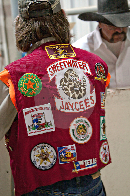 Patches decorate the vest of a Jaycee volunteer snake handler during the 51st Annual Sweetwater Texas Rattlesnake Round-Up March 14, 2009 in Sweetwater, Texas. During the three-day event approximately 240,000 pounds of rattlesnake will be collected, milked and served to support charity.