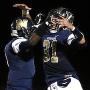North Brunswick's Kevon Perkins, left and Randy Clark celebrate a touchdown in the first half. (Jason A. Frizzelle)