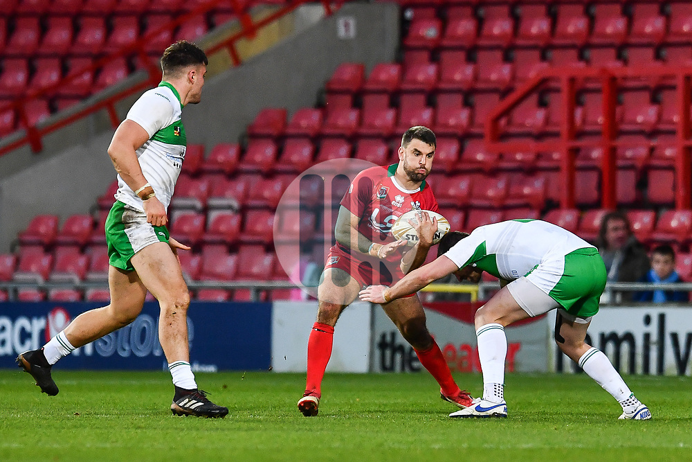 11th November 2018 , Racecourse Ground,  Wrexham, Wales ;  Rugby League World Cup Qualifier,Wales v Ireland ; Elliot Kear of Wales is tackled by Greg McNally of Ireland <br /> <br /> <br /> Credit:   Craig Thomas/Replay Images