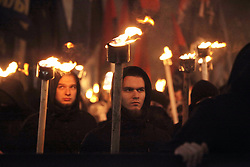 January 29, 2018 - Kharkiv, Ukraine - Participants carry burning torches during a torchlight procession marking 100 years since the Battle of Kruty, Kharkiv, northeastern Ukraine, January 29, 2018. Ukrinform. Ukrinform..The nation commemorates the perished Kruty Heroes by holding torchlight processions. Marchers are paying tribute to hundreds of soldiers of the Ukrainian People's Republic, mostly students, who sacrificed their lives while fighting to delay the advancement of the Bolshevik Red Army near the Kruty railway station in late January 1918. (Credit Image: © Dmytro Smolyenko/Ukrinform via ZUMA Wire)