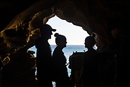 Hercules Cave, Morocco - May 15, 2018: Mackenzie, Clancy, and Kirby, three traveling siblings from Australia, stand inside Hercules Cave near Tangier, Morocco.