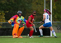 Laconia goalie Sierra Keets saves a goal attempt by Gilford's Kellie Ryan during NHIAA Division III field hockey on Wednesday afternoon.  (Karen Bobotas/for the Laconia Daily Sun)