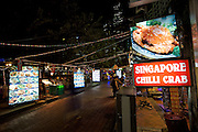 Nightlife along Singapore River. Singapore Chili crab in waterfront restaurants at Boat Quay.