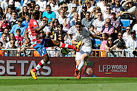 Real Madrid´s James Rodriguez and Granada´s Dimitri Foulquier during 2014-15 La Liga match between Real Madrid and Granada at Santiago Bernabeu stadium in Madrid, Spain. April 05, 2015. (ALTERPHOTOS/Luis Fernandez)