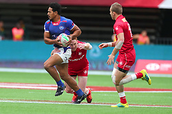 March 9, 2019 - Vancouver, BC, U.S. - VANCOUVER, BC - MARCH 09: Tila Mealoi (9) of Samoa avoids the tackle from Connor Braid (6) of Canada during day 1 of the 2019 Canada Sevens Rugby Tournament on March 9, 2019 at BC Place in Vancouver, British Columbia, Canada. (Photo by Devin Manky/Icon Sportswire) (Credit Image: © Devin Manky/Icon SMI via ZUMA Press)