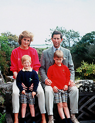 """Embargoed to 0001 Monday August 21 File photo dated 01/06/89 of the Prince and Princess of Wales with sons Prince William, right, and Prince Harry relaxing in Tresco during their holiday in the Scilly Isles.Diana, Princess of Wales was a woman whose warmth, compassion and empathy for those she met earned her the description the """"people's princess""""."""