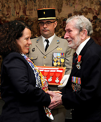 Veteran Joseph Dow, 95, from Coventry, receives the Legion d'honneur, France's highest distinction, from the French Ambassador Sylvie Bermann for his role in liberating France during the Second World War, during a ceremony at the Ambassador's residence in Kensington, London.