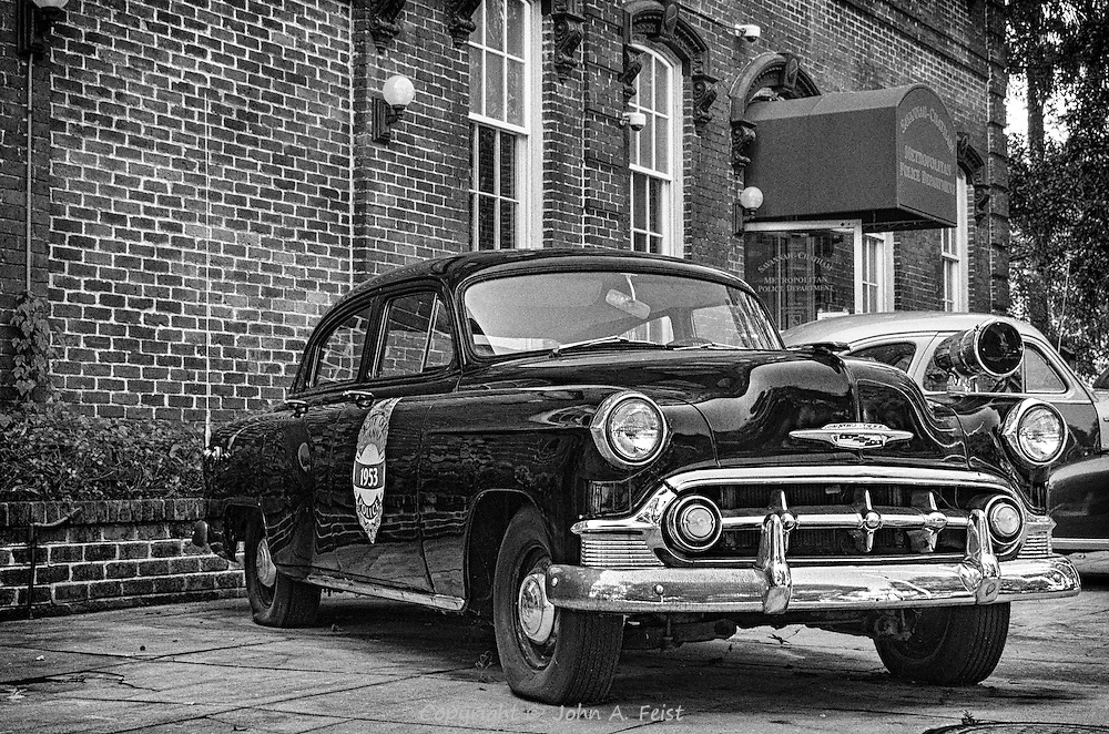 One of the great things about walking around Savannah is that you never know what is around the next corner.  We came across a group of vintage police cars on display in front of a police station.  I like the black and white treatment as that's what they would have used in 1953.