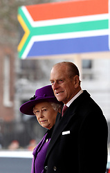 The Duke of Edinburgh and Britain's Queen Elizabeth II wait to greet South African President Jacob Zuma during a ceremonial welcome on Horse Guards Parade, London.