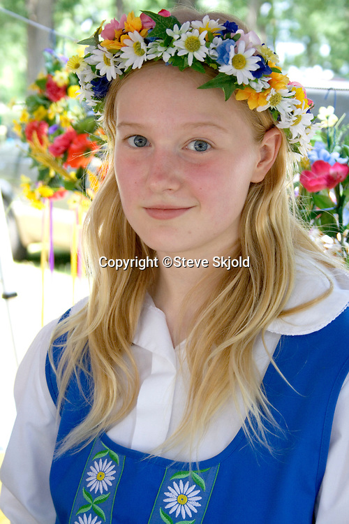 Young teen dressed in traditional outfit. Svenskarnas Dag Swedish Heritage Day Minnehaha Park Minneapolis Minnesota USA