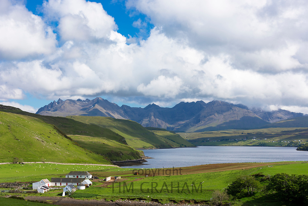 Clouds over the Cuillin mountain range with croft farm and Loch Harport near Coillure on Isle of Skye in the Highlands and Islands of Scotland