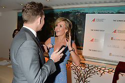 AMANDA HOLDEN and NICK CANDY at the Fortune Forum Club dinner in the presence of HSH Prince Albert II of Monaco held at The Dorchester, Park Lane, London on 15th January 2014.