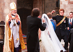 STRICT EMBARGO TO 00:01 FRIDAY 15 APRIL 2011 © licensed to London News Pictures. LONDON, UK  12/04/11. The Archbishop of Canterbury and Prince HRH Prince William dance. The filming of a new T-Mobile advert in which Kate Middleton and Prince William lookalikes pretend to get married at a mock royal wedding. The filming took place at St Bartholomew the Great Church in London. All the main royal family members and the Arch Bishop of Canterbury were played by actors. The actors danced down the aisle with moves choreographed by Louie Spence. Please see special instructions. Photo credit should read Cliff Hide/LNP.