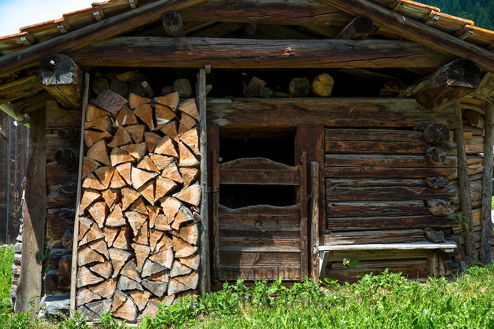 Woodpile of stacked logs at chalet barn in Klosters in Graubunden region, Switzerland