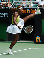 """MELBOURNE AUSTRALIAN OPEN   17/01/05<br />SERENA WILLIAMS (USA) PRACTICES HER JOHN CLEESE """"MINISTRY OF SILLY WALKS"""" IMPERSONATION DURING FIRST ROUND WIN<br />Photo Roger Parker  Fotosports International"""