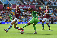 Patrick van Aanholt of Sunderland © looks to go past Alan Hutton of Aston Villa. Barclays Premier League match, Aston Villa v Sunderland at Villa Park in Birmingham, Midlands on Saturday 29th August  2015.<br /> pic by Andrew Orchard, Andrew Orchard sports photography.