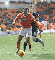 Blackpool's Nathan Delfouneso battles with  Millwall's Martyn Woolford<br /> <br /> Photographer Mick Walker/CameraSport<br /> <br /> Football - The Football League Sky Bet Championship - Blackpool v Millwall - Saturday 10th January 2015 - Bloomfield Road - Blackpool <br /> <br /> © CameraSport - 43 Linden Ave. Countesthorpe. Leicester. England. LE8 5PG - Tel: +44 (0) 116 277 4147 - admin@camerasport.com - www.camerasport.com