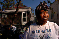 """""""We went to Baton Rouge...then to Shelton...I have to go back, because we cant stay here.""""  New Orleans resident, Theresa Odom's, home was destroyed by floodwaters following Hurricane Katrina two months prior. ..."""