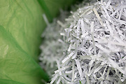 A detail of shredded domestic documents and paperwork in a waste paper bin lined with green polythene bag, a precaution against identity theft and to ensure one's personal data is protected from fraud, on 12th June 2020, in London, England.