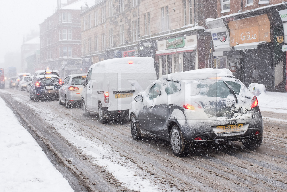 """© Licensed to London News Pictures. 28/02/2018. <br /> <br /> Heavy traffic on Pollockshaws Road, Glasgow, Scotland as the city hit with snow storm """"Beast from the East"""" on 28th February 2018.<br /> <br /> Photo credit should read Max Bryan/LNP"""
