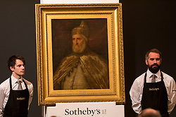"© Licensed to London News Pictures. 07/12/2016. London, UK. ""Portrait of Doge Andrea Gritti"" by workshop of Tiziano Vecellio, called Titian which sold for a hammer price of GBP105k (est. 80-120k), at the Old Masters Evening Sale at Sotheby's in New Bond Street. Photo credit : Stephen Chung/LNP"