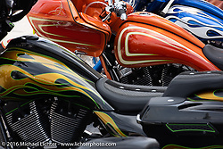 Colorful display of Eddie Trotta baggers by his booth on Main Street during Daytona Bike Week's 75th Anniversary event. FL, USA. Saturday March 12, 2016.  Photography ©2016 Michael Lichter.