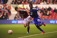 Middlesbrough's Mustapha Carayol is fouled by Nottingham Forest's Eric Lichaj <br /> <br /> Photo by Chris Vaughan/CameraSport<br /> <br /> Football - The Football League Sky Bet Championship - Nottingham Forest v Middlesbrough - Tuesday 17th September 2013 - The City Ground - Nottingham<br /> <br /> © CameraSport - 43 Linden Ave. Countesthorpe. Leicester. England. LE8 5PG - Tel: +44 (0) 116 277 4147 - admin@camerasport.com - www.camerasport.com