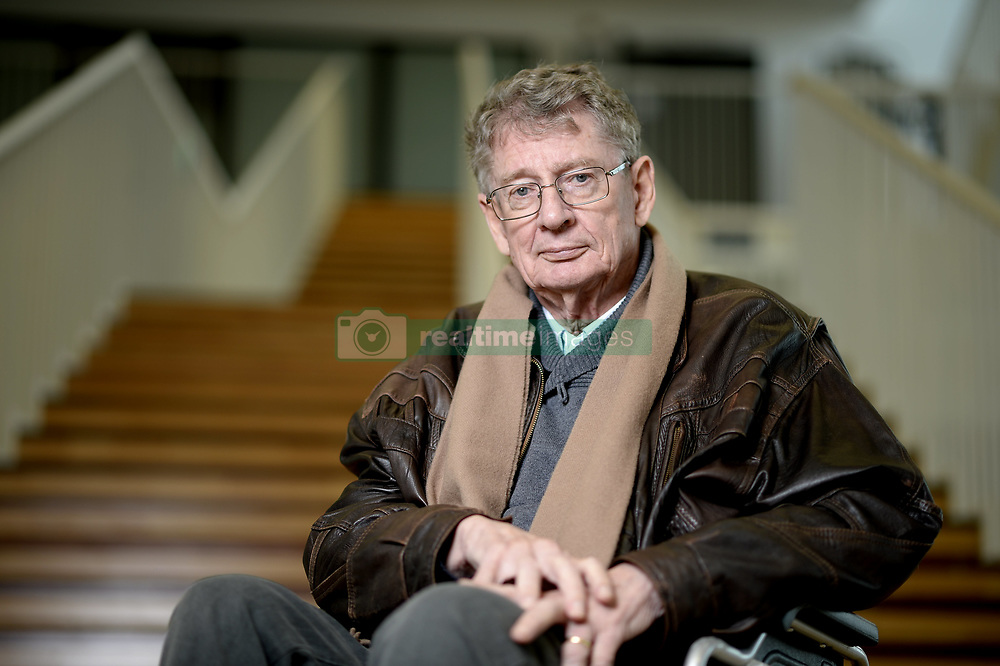 February 6, 2015 - File - South African writer ANDRE BRINK, one of the most outspoken critics of the apartheid regime, has died. Brink, 79, died Friday night on board a flight to Cape Town after visiting Belgium where he had received an honorary doctorate,. Brink wrote both in Afrikaans as well as English. His novels have been translated in more than 30 languages. Some of his books, including 'A Dry White Season' which was turned into a film, were banned in South Africa. Other novels include 'Looking on Darkness' and 'Philida' for which he was shortlisted for the Man Booker Prize in 2012. Andre Brink was a literature professor at the University of Cape Town at the time of his death. Pictured - Feb. 2, 2015 - Louvain-La-Neuve, Belgium - South African novelist Andre Brink poses after a press conference of the new Doctors Honoris Causa before the ceremony for the honorary degrees at the UCL Louvain-La-Neuve university. (Credit Image: © Eric Lalmand/Belga/ZUMA Wire)