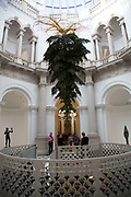 Interior of Tate Britain gallery with upside down suspended Christmas tree in London, England, United Kingdom. (photo by Mike Kemp/In Pictures via Getty Images)
