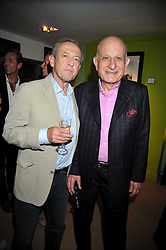 Left to right, DAN TOPOLSKI and NAIM ATTALLAH at a party to celebrate the publication of Joth Shakerley's book 'Pregnant Women' held at 598a Kings Road, London SW6 on 20th May 2009.