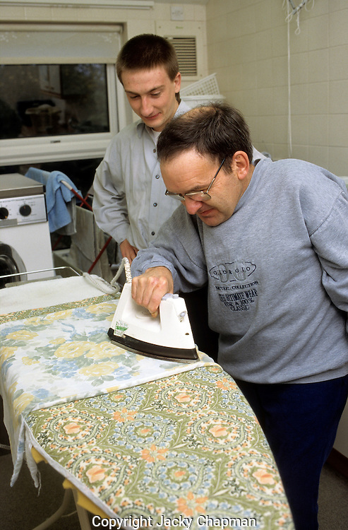 Disabled man learning to ironing and doing  domestic chores