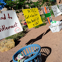 072215  Adron Gardner/Independent<br /> <br /> A figurative laundry line of signs arranged by women from Dilkon AZ and San Juan Basin hangs outside the Navajo Nation Tribal Council Chambers in Window Rock Wednesday.