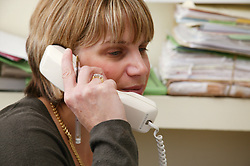 Haematology Clinic Consultant answering the telephone,