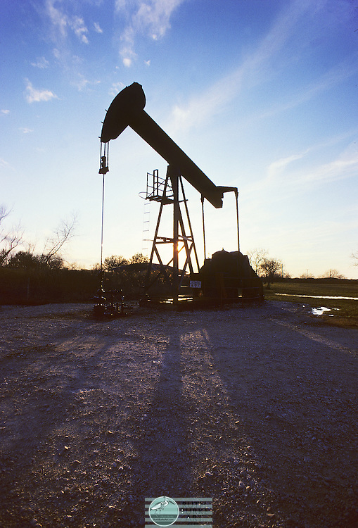 A pumpjack (also called nodding donkey, pumping unit, horsehead pump, rocking horse, beam pump, dinosaur, sucker rod pump (SRP), grasshopper pump, thirsty bird, or jack pump) is the overground drive for a reciprocating piston pump in an oil well.<br /> It is used to mechanically lift liquid out of the well if there is not enough bottom hole pressure for the liquid to flow all the way to the surface. The arrangement is commonly used for onshore wells producing little oil. Pumpjacks are common in oil-rich areas.