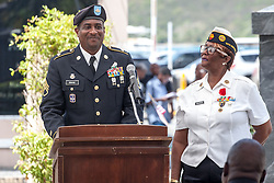 Keynote speaker SSG Rae Rouse of the Virgin Islands National Guard speaks before the audience gatered in Franklin D. Rooselvelt Park for the Memorial Day Ceremony.  St. Thomas Memorial Day Ceremony and Parade.  Franklin D. Roosevelt Veterans Park.  St. Thomas, USVI.  30 May 2016.  © Aisha-Zakiya Boyd
